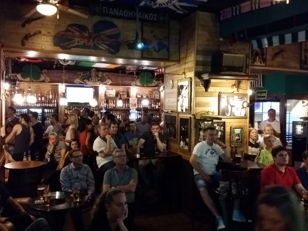 People in the best irish pub barcelona see the big screen